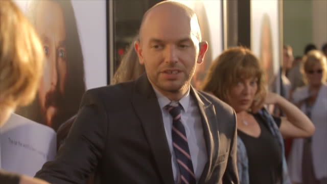 MCU Paul Scheer posing for paparazzi with wife June Diane Raphael on the red carpet at the Arclight Cinerama Dome
