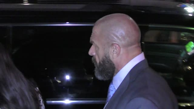 vídeos y material grabado en eventos de stock de paul 'triple h' levesque & stephanie mcmahon leave the andre the giant premiere at arclight cinerama dome in hollywood in celebrity sightings in los... - cinerama dome hollywood