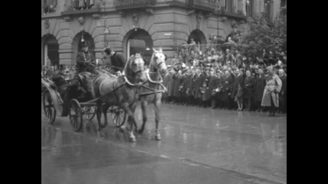 Paul von Hindenburg president of Germany sits in carriage with dignitary as he visits the city of Braunschweig / rear shot carriage drives away...