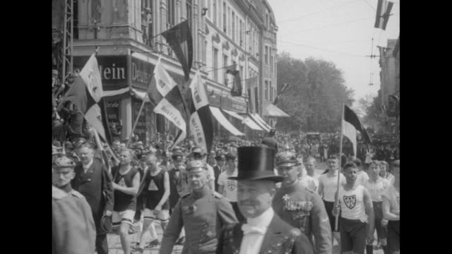 paul von hindenburg wearing a pointed pickelhaube walks along street in allenstein east prussia followed by young men in running clothes he speaks... - traditional helmet stock videos and b-roll footage