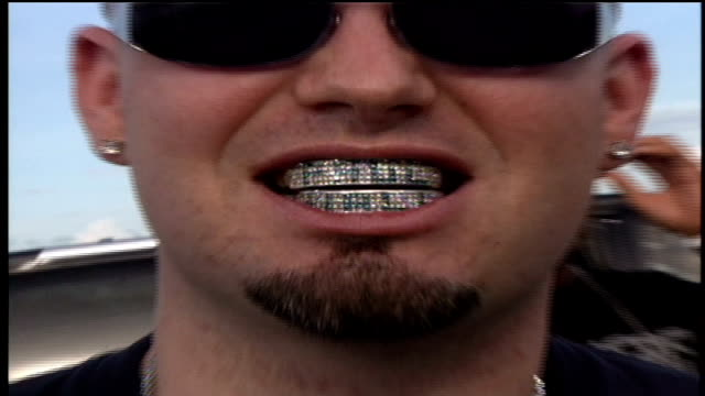 paul wall posing for pictures showing off his grillz and necklace while on the red carpet - showing off stock videos & royalty-free footage