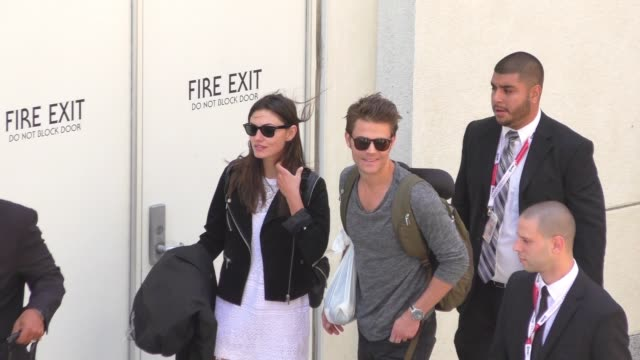 Paul Wesley Phoebe Tonkin waiting for their car at Comic Con in San Diego on July 12 2015 in San Diego California
