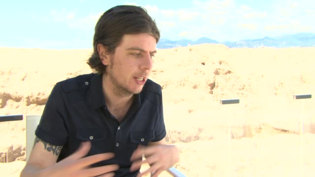 stockvideo's en b-roll-footage met interview paul wright on the character of george mackay at 'for those in peril' interviews at nespresso beach on may 19 2013 in cannes france - george mackay