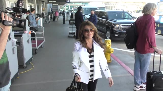 INTERVIEW Paula Abdul talks about how many shoes she owns while departing at LAX Airport in Los Angeles in Celebrity Sightings in Los Angeles