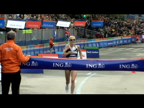paula radcliffe running race / crossing finish line / holding baby daughter after race / wrapping herself in british flag paula radcliffe wins nyc... - finish line stock videos & royalty-free footage