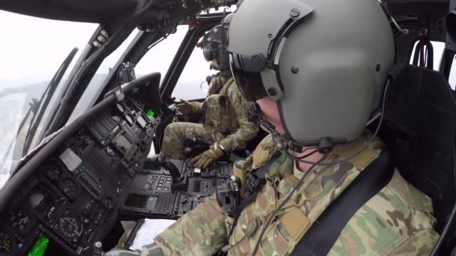 pave hawk crew members and pararescuemen from the 33rd rescue squadron launch for a search and rescue training mission at osan air base, republic of... - herunterlassen stock-videos und b-roll-filmmaterial