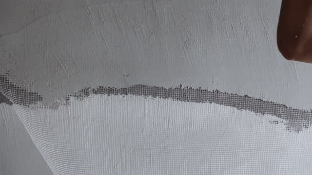 pave the putty powder on the wall with nylon mesh net - mesh textile stock videos & royalty-free footage