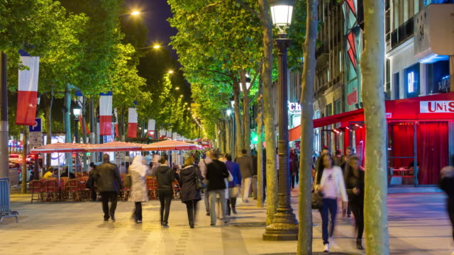 Pavement cafes and people on the Champs Elysees avenue, Paris, France - time lapse