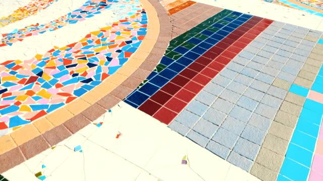vídeos de stock e filmes b-roll de pavement made of multicolored tile floor stone, beautiful garden walkway - chão de azulejo