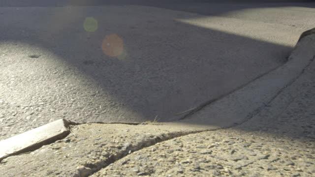 pavement - rinnsteinkante stock-videos und b-roll-filmmaterial