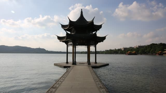 pavilion on the west lake against blue sky,hangzhou,china - pavilion stock videos & royalty-free footage