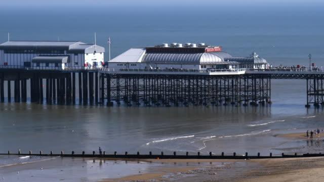 ws zo pavilion theatre on cromer pier and beach, cromer, norfolk, united kingdom - pier stock videos & royalty-free footage