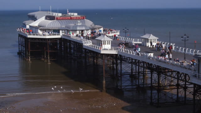 ws zo pavilion theatre on cromer pier and beach, cromer, norfolk, united kingdom - pavilion video stock e b–roll