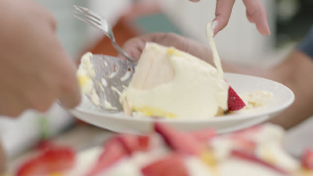 pavlova being served onto plate - kuchen stock-videos und b-roll-filmmaterial