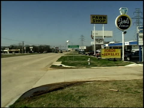 pawn shop in texas strip mall - pawnbroker stock videos & royalty-free footage