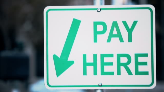 pay here paid parking sign and kiosk - fee stock videos & royalty-free footage