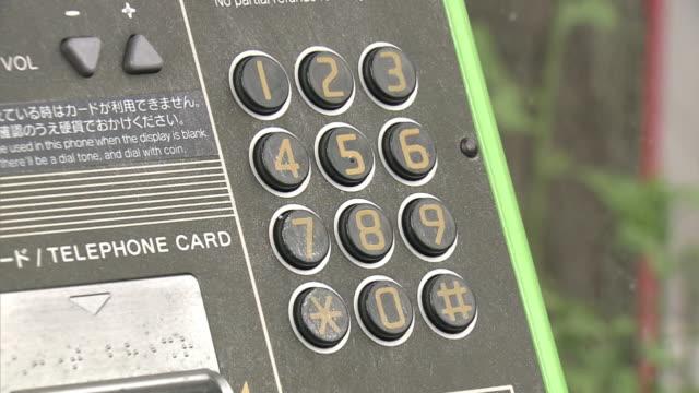 cu, pay phone, kanagawa, japan - telephone receiver stock videos & royalty-free footage