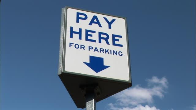 LA, ZI, ECU pay station sign on parking