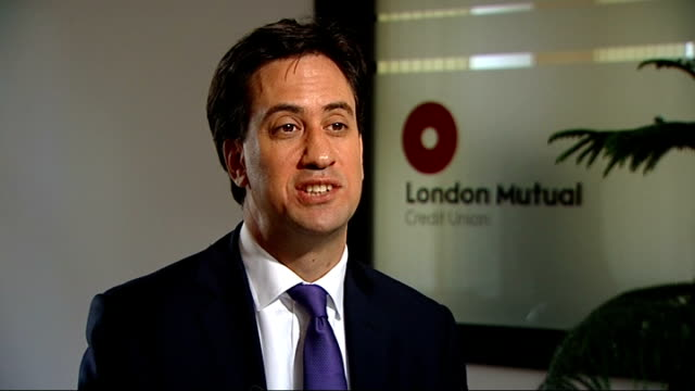 credit union visit and ed miliband interview ed miliband mp interview sot want payback from payday lenders / will force them to fund low cost lending... - credit union stock videos & royalty-free footage