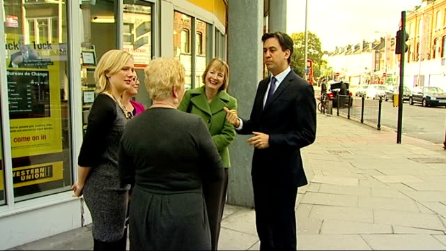 credit union visit and ed miliband interview england london peckham photography*** gvs ed miliband mp along with harriet harman mp along to london... - credit union stock videos & royalty-free footage