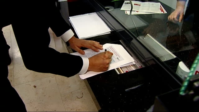 credit union visit and ed miliband interview int gvs miliband meets staff inside / gvs photo op miliband fills out form signs up at counter / gvs... - credit union stock videos & royalty-free footage