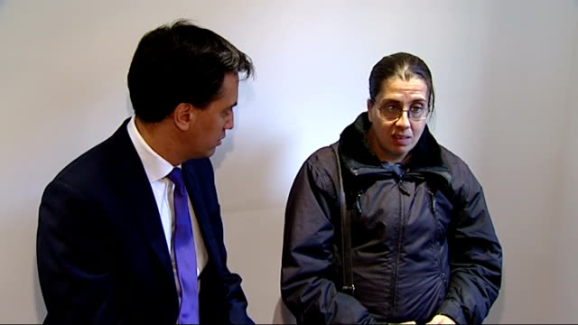 credit union visit and ed miliband interview various shots of ed miliband sitting at table chatting to female customers sot / harriet harman sitting... - credit union stock videos & royalty-free footage