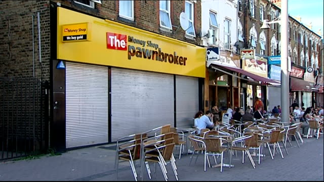 london walthamstow ext exteriors of 'cash generator' shop / 'payday advance' sign / 'the money shop pawnbroker' store / 'the money shop we buy gold'... - pawnbroker stock videos & royalty-free footage