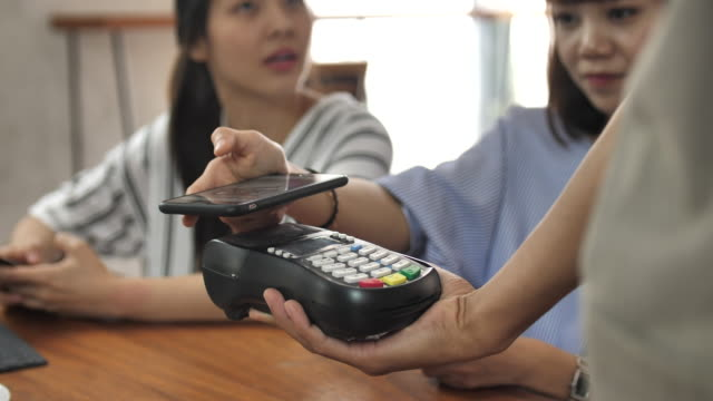 paying contactless payment with smartphone - exchanging stock videos & royalty-free footage