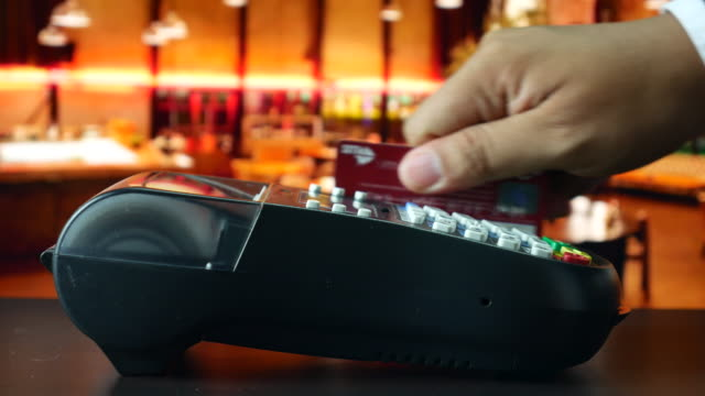 paying with credit card in restaurant - smart card stock videos & royalty-free footage
