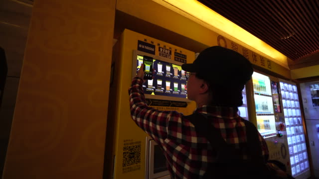 paying with wechat or alipay people can buy various drinks including fresh ground coffee from the selfservice machine - coffee variation stock videos & royalty-free footage