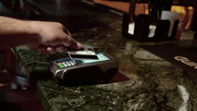 paying with wireless credit card in a bar - credit card purchase stock videos & royalty-free footage