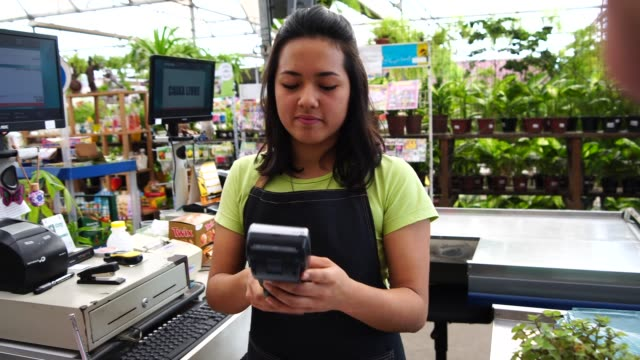 payment with a credit card at the florist - garden center stock videos and b-roll footage