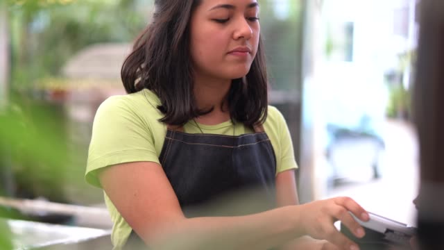 payment with a credit card at the florist - cashier stock videos & royalty-free footage