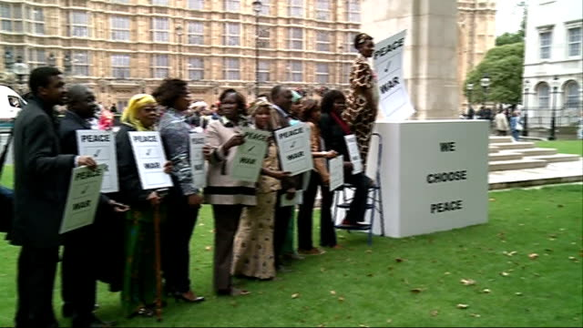 peace campaigners in westminster england london ext gvs peace campaigners outside the palace of westminster / protesters with placards / natsot... - ballot box stock videos & royalty-free footage