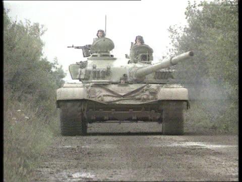 peace efforts; nr vukovar ext tank along towards itn tx 14.10.91 - serbia stock videos & royalty-free footage