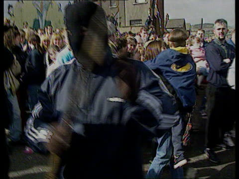 peace itn n ireland belfast night irvine i/c ira gunmen wearing balaclavas and carrying guns thru cheering crowd at easter rally track round belfast... - john major stock videos & royalty-free footage