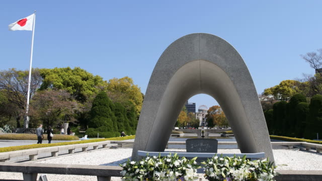 peace memorial park with peace flame and a-bomb dome in background, hiroshima, japan - hiroshima prefecture stock videos and b-roll footage