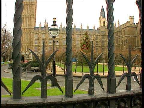stockvideo's en b-roll-footage met peace plan negotiations to continue england london westminster gv palace of westminster tilt gv palace of westminster zoom in to christmas tree house... - house of commons