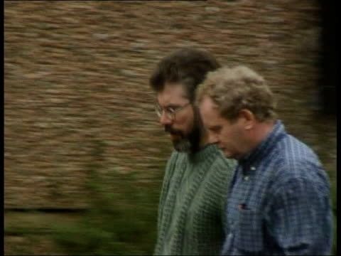 peace process; c4n: gary gibbon northern ireland: belfast: stormont: ext i/c martin mcguinness mp & gerry adams mp along past through grounds int... - 30 seconds or greater stock-videos und b-roll-filmmaterial