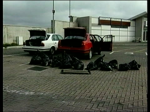 peace process car bombs found itn dun laoghaire ferry terminal pull out to two bmw cars with boots open and bags of explosive laid around cars with... - ferry terminal stock videos & royalty-free footage