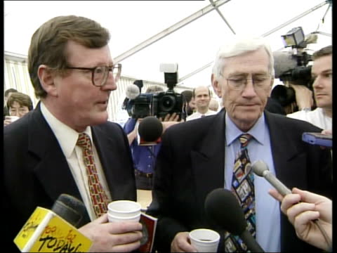 Peace talks Disarmament report INT CMS BV David Trimble and Seamus Mallon getting coffee in refreshment tent David Trimble SOT You may speculate...