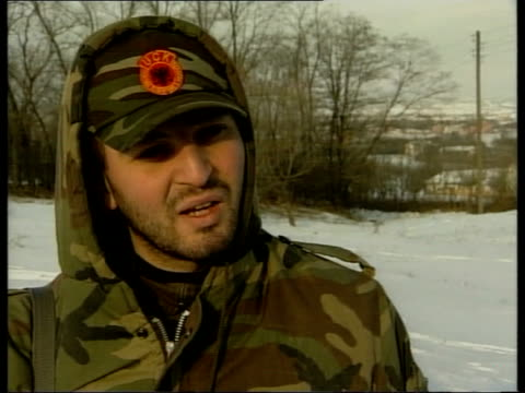 peace talks; peace talks; itn kla soldiers standing around in snow lirak interviewed sot - i joined because i thought it was the only way that we... - serbia stock videos & royalty-free footage