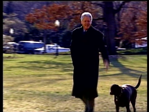 peace talks preparations/violence middle east peace talks preparations/violence pool us president bill clinton walking along with dog buddy as waves... - us president stock videos & royalty-free footage