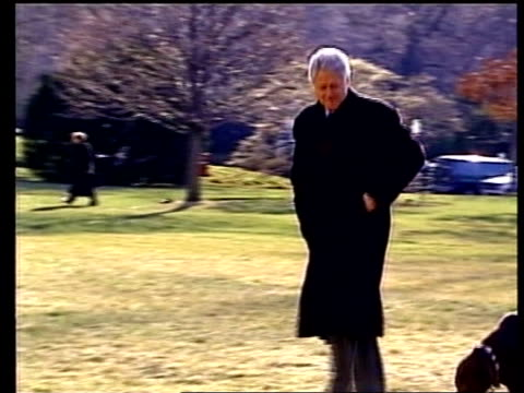 peace talks preparations/violence pool us president bill clinton walking along with dog buddy as waves to press pan as catches up with wife hillary... - us president stock videos & royalty-free footage