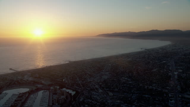 Peaceful aerial landscape of the Santa Monica Bay in Los Angeles County, California at sunset.