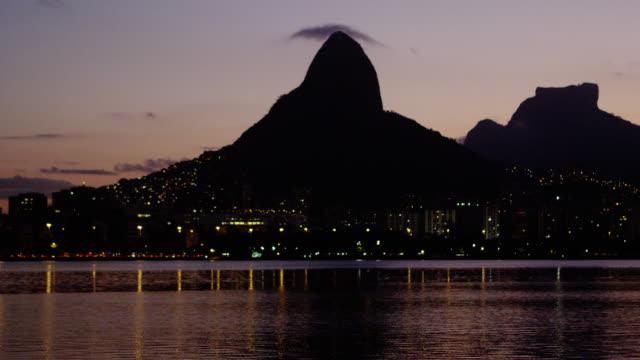 peaceful bay and city lights - rio de janeiro, brazil. - ウォーターフロント点の映像素材/bロール