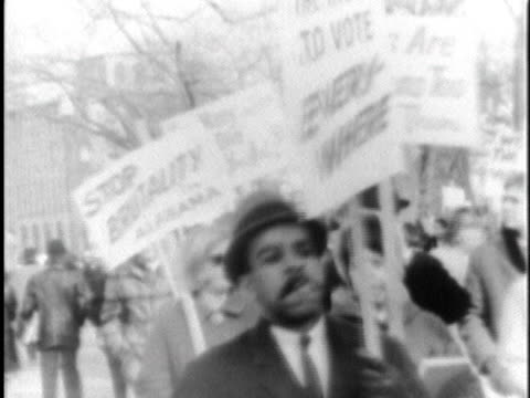 peaceful black and white civil rights protesters carry signs in selma, alabama, declaring the need for justice and stopping police brutality. - 1965 stock videos & royalty-free footage