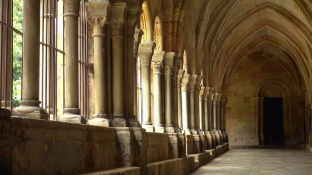 peaceful hallway of cathedral of tarragona spain - abbey stock videos & royalty-free footage