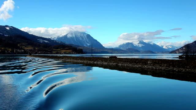 peaceful lake thun and alps - lake thun stock videos and b-roll footage