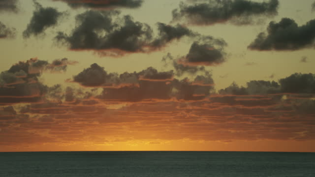 Peaceful Orange Sky Over Sea At Dawn